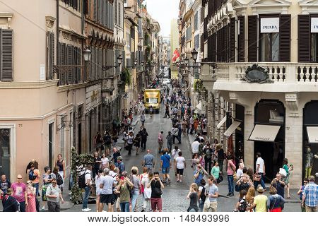 ROME ITALY - JUNE 15 2015: Via Condotti in Rome. This street is the center of fashion shopping in Rome with the atelier of Bulgari Armani Cartier Fendi Gucci and others.
