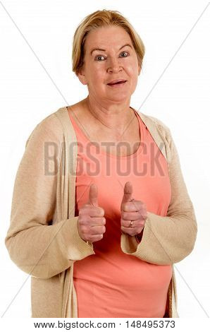 female senior is happy and full of expression for it shows up her thumb isolated on white background