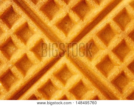 close up of rustic golden plain waffle food background