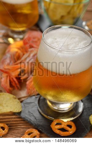 Beer and snacks on a brown background