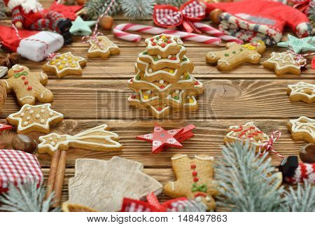 Different Christmas decorations on brown background close up