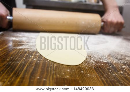 Preparation Of The Dough. Cook Rolls Out The  On The Board.