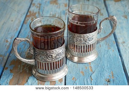 Cups of tea on the old wooden table. Texture background exterior