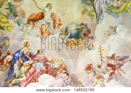 VIENNA AUSTRIA - NOVEMBER 232013: The Karlskirche (St. Charles's Church). Vibrant frescoes of saints and angels decorate the vaulted interior dome of Viennas Karlskirche.