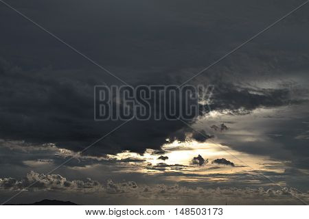 Background of the sky with cloud at sunset, dramatic evening cloudscape over sea