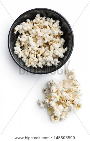 Tasty salted popcorn in bowl isolated on white background.
