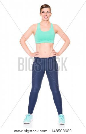Young and sporty woman in front of white background