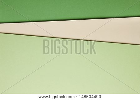 Colored cardboards background beige green tone. Copy space. Horizontal