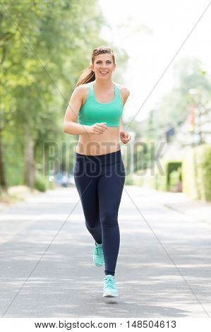 Running young woman outdoor