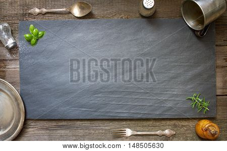 Old retro culinary menu abstract background on black stone