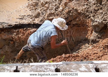 selective focus workers dig hole plumbing repair on the road