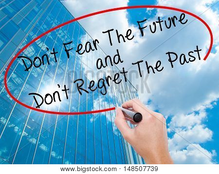 Man Hand Writing Don't Fear The Future And Don't Regret The Past With Black Marker On Visual Screen