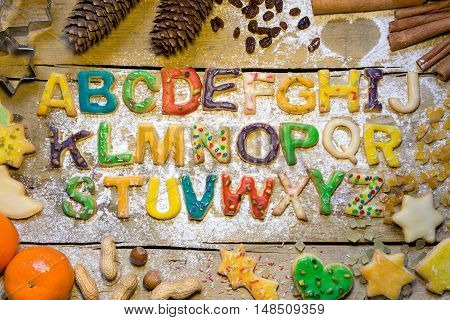 Seasonal Decoration And Cookie Alphabet On Wooden Table