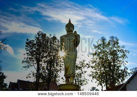 Buddha statue with sun on his hand at Wat Pra That Kao Noi Nan
