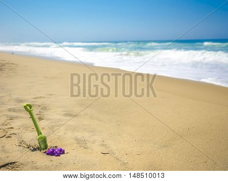 Little shovel on beach