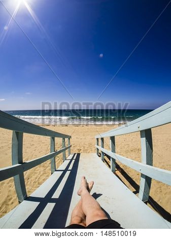 Lying on a rescue hut at beach in California