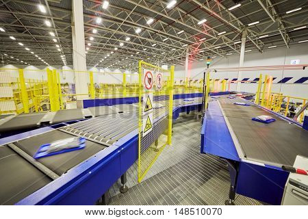 RUSSIA, MOSCOW - DEC 16, 2014: Parcels on a conveyor for sorting in the automated sorting center in Vnukovo. Moscow Automated sorting center - the largest in Eastern Europe.