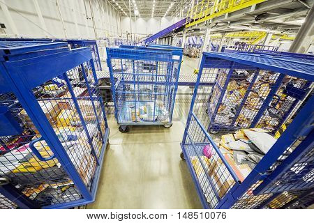RUSSIA, MOSCOW - DEC 16, 2014: Carts with parcels and letters in post department of automated sorting center in Vnukovo. Moscow Automated sorting center - the largest in Eastern Europe.