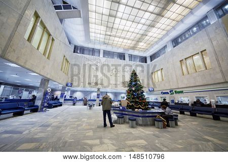 RUSSIA, MOSCOW - DEC 16, 2014: People in the hall of Russian Post department.