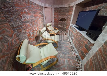 RUSSIA, MOSCOW - 10 DEC, 2014: Three rocking-chairs and TV in a marble surface cabin at the Rehabilitation Center Fire and Rescue.