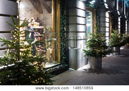 MOSCOW, RUSSIA - JAN 1, 2015: Facade of the GUM with christmas decoration and garlands on the fir.