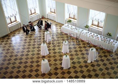 RUSSIA, MOSCOW - 05 MAR, 2015: Top view of violinists group are performing at literary award Yasnaya polyana in the Pashkov house.