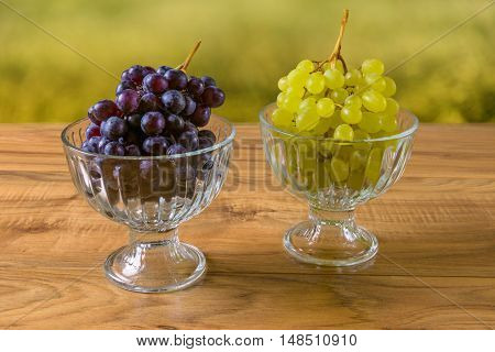 Fresh ripe grapes on the wooden table rustic style