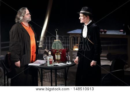 RUSSIA, MOSCOW - APR 15, 2015: Two actors are playing their character of performance (Kosmos) at drama theatre Modern.