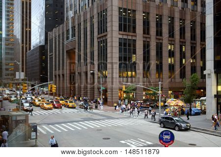 NEW YORK - August 23, 2014: people cars and Skyscrapers at 6th ave