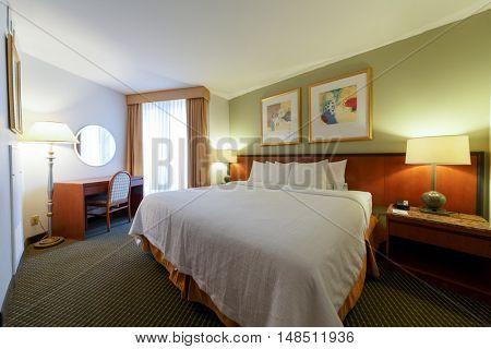 PHILADELPHIA - September 2, 2014: bedroom in Embassy Suites