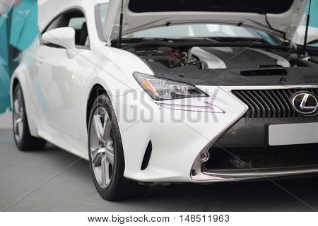MOSCOW - FEB 14, 2015: Stylish white car with an open hood in a motor show on Russian sixth test drive Lexus Master Class