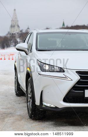 MOSCOW - FEB 14, 2015: White stylish car on winter road on a test drive in Kolomenskoye