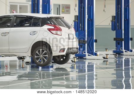 interior car-care center. The electric lift for cars in the service
