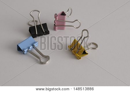 Colorful binder clips isolated on a white background