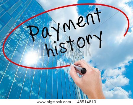 Man Hand Writing Payment History With Black Marker On Visual Screen