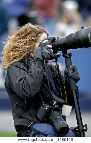 Female Photographer With Long Lens