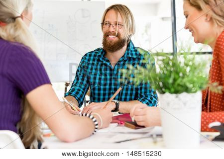 Young office workers discussing
