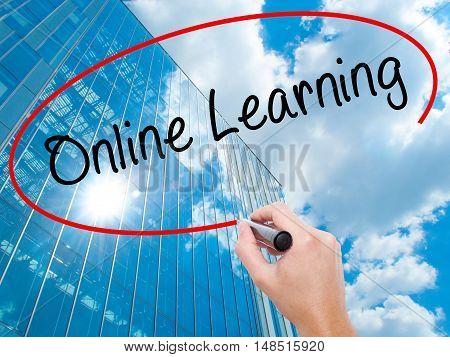 Man Hand Writing Online Learning With Black Marker On Visual Screen