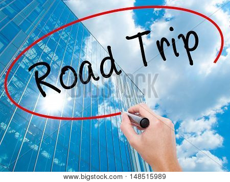 Man Hand Writing Road Trip With Black Marker On Visual Screen