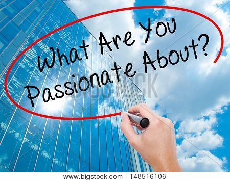 Man Hand Writing What Are You Passionate About?  With Black Marker On Visual Screen