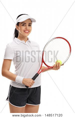 Female tennis player posing with a ball and a racket isolated on white background