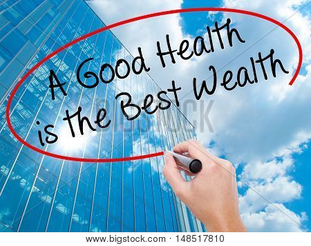Man Hand Writing A Good Health Is The Best Wealth With Black Marker On Visual Screen