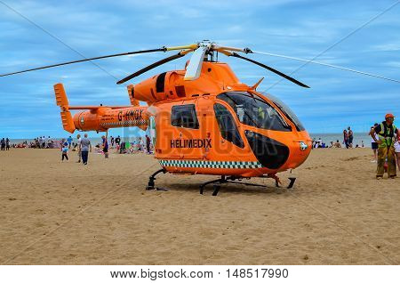 Skegness-England 09 August 2015 Air Ambulance helicopter during medical emergencies rescue on the beach in Skegness. Editorial photo.