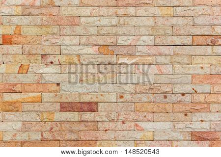 Sandstone brick wall texture Stone background pattern and color