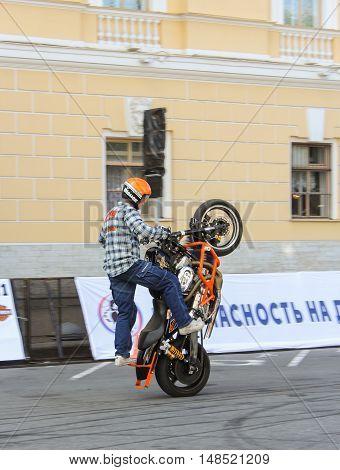 St. Petersburg, Russia - 12 August, Demonstrative performance biker,12 August, 2016. The annual International Festival of Motor Harley Davidson in St. Petersburg Ostrovsky Square.