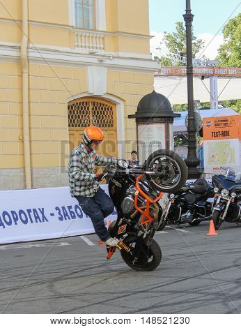 St. Petersburg, Russia - 12 August, Bike riding on the rear wheel,12 August, 2016. The annual International Festival of Motor Harley Davidson in St. Petersburg Ostrovsky Square.