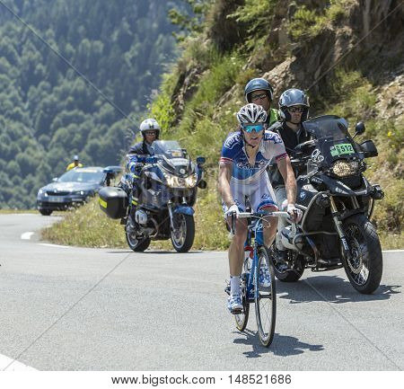 Col D'AspinFrance- July 152015: The French cyclist Arnaud Demare of FDJ Team climbing the road to Col D'Aspin in Pyrenees Mountains during the stage 11 of Le Tour de France 2015.