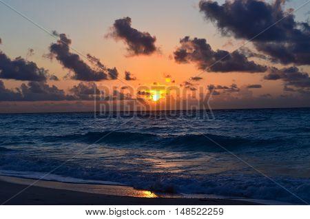 Senset on the sea beach in dark colors in Cancun