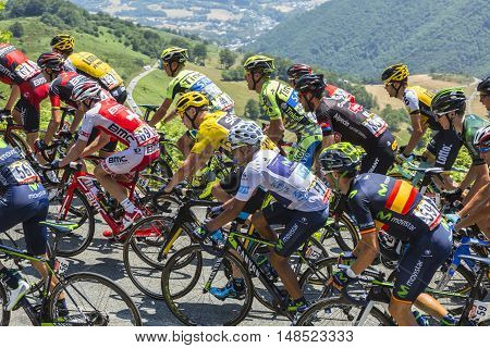 Col D'AspinFrance- July 152015: Froome of Team sky in Yellow Jersey and his main rival Quintana of Movistar Team in White Jersey climbinginside the peloton the road to Col D'Aspin in Pyrenees Mountains during the stage 11 of Le Tour de France 2015.