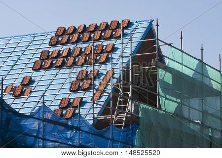 Stacks of roof tiles on a roof under construction in the Netherlands